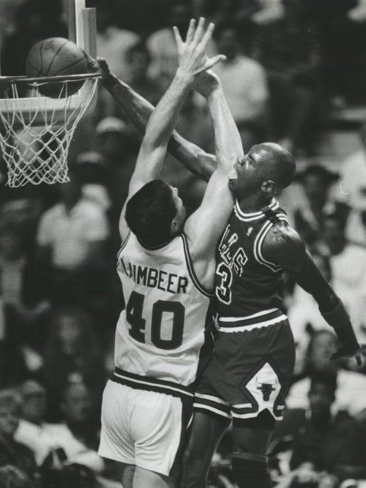 wholesale dealer 2e7be 5021a Michael Jordan slams home two over Pistons center Bill Laimbeer.
