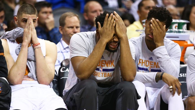 The Phoenix Suns bench reacts to a Minnesota Timberwolves basket in the 4th quarter on Jan. 24, 2017 in Phoenix, Ariz.