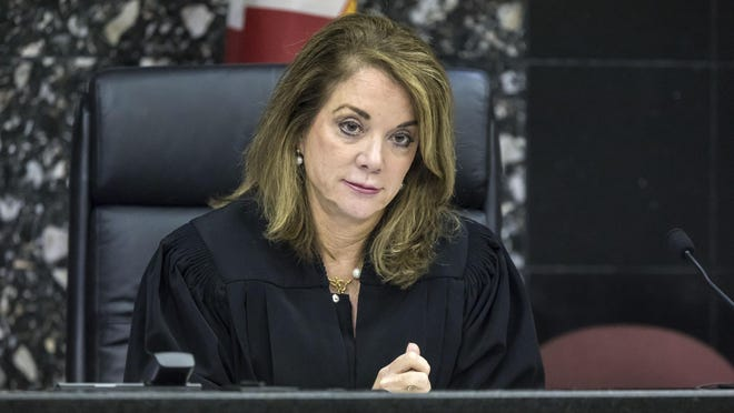 Chief Circuit Judge Krista Marx listens to Aliette Rodz, representing Rick Scott, during Friday's hearing.