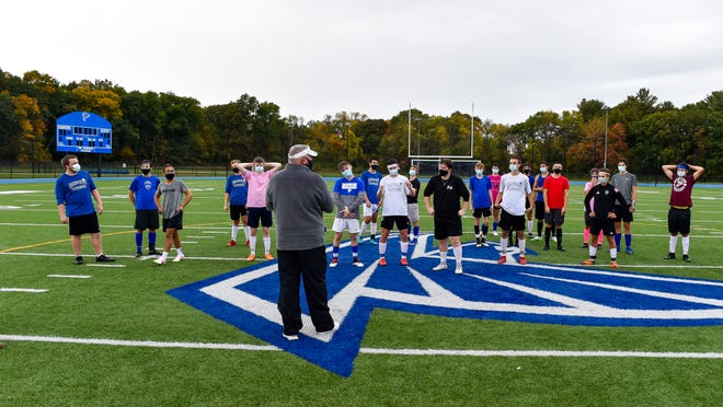 Danvers boys assistant varsity soccer coach Jamie Kidney is shown addressing the team at the end of practice at Danvers High School on Friday, Oct. 2. The Falcons have since started the season, and are currently 2-3, before being shutdown last week, because of COVID concerns, stemming from a recent game at Swampscott. They are scheduled to resume the season on Wednesday, Nov. 11.