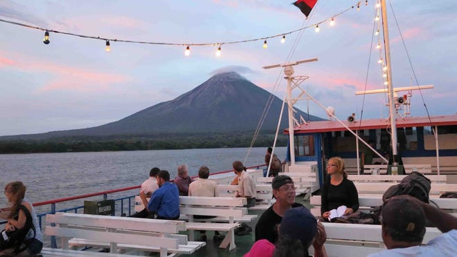 Concepcion Volcano looms in the background as a ferry approaches Nicaragua's Ometepe Island. The island, on the shores of Lake Nicaragua, is a paradise for adventurers and nature lovers.