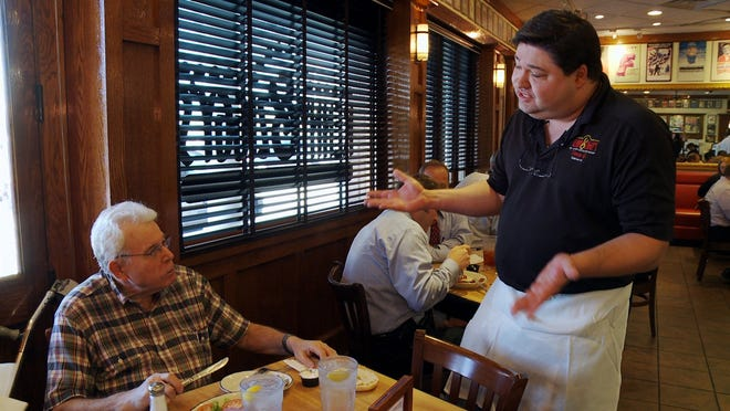 "David (Ziggy) Gruber, right, co-owner of Kenny & Ziggy's New York Delicatessen Restaurant in Houston, chats up a customer in ""Deli Man."""