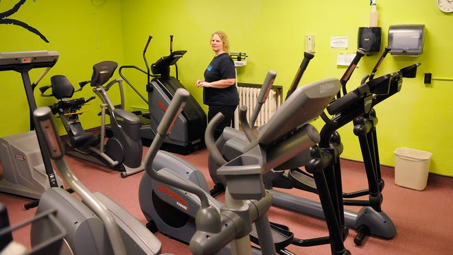 St. Francis Health & Recreation Center Director Angie Sahr walks through the facility's cardio-exercise room Wednesday. The center is hosting its first fitness camp for children starting June 16.