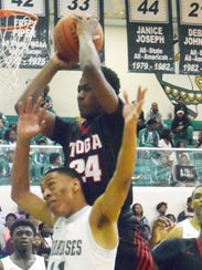 Tioga's Ty Sanders (24) grabs a rebound in the Hall
