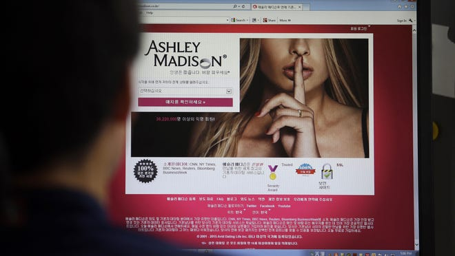 The Ashley Madison website is shown on a computer screen in Seoul, South Korea. The site, billed as a matchmaker for cheating spouses, was hacked and subscriber information has been posted online.