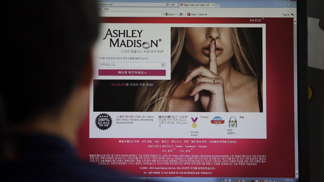 Ashley Madison's Korean website on a computer screen in Seoul, South Korea. Several people across the U.S. who registered to use the site, including a California man, are suing the parent company after hackers released personal and financial information on them and millions of other users.