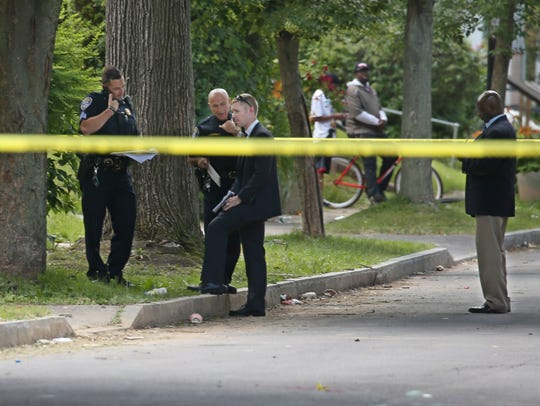 Rochester Police investigate the scene of a shooting