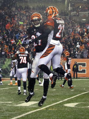 CINCINNATI, OH - DECEMBER 22:  Darqueze Dennard #21 of the Cincinnati Bengals congratulates Dre Kirkpatrick #27 of the Cincinnati Bengals after he returned an interception for a touchdown during the fourth quarter of the game against the Denver Broncos at Paul Brown Stadium on December 22, 2014 in Cincinnati, Ohio. Cincinnati defeated Denver 37-28. (Photo by John Grieshop/Getty Images)
