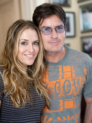 Brooke Mueller and Charlie Sheen, then married, pose at an event in 2009.