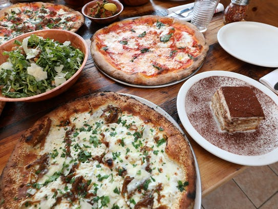 The white pizza and margherita pizza along with an