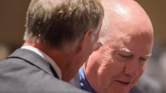 Michael Sentance talks with Gov.Robert Bentley after the Alabama State Board of Education voted to ratify Sentance's contract.