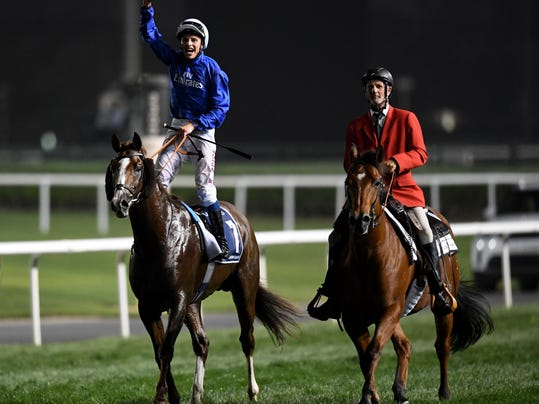 Jockey William Buick celebrates on Godolphin's Hawkbill victory in the $6 million Group 1 Dubai Sheema Classic over 2410m in Dubai, the United Arab Emirates, Saturday, March 31, 2018. (AP Photo/Martin Dokoupil)