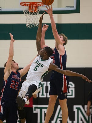 Veterans Memorial's Will Chayer jumps to block a shot by King's TK Smith during the second quarter of their game at King High School on Jan. 24, 2017.  Reuben Lewis