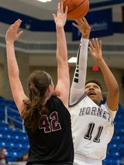 Four Bluff's Armani Anderson has her shot blocked by Stephen F. Austin's Mia Head during the first half of the Region IV-5A Tournament championship game at Northside Spots Gym in San Antonio on Saturday, Feb. 25, 2017.
