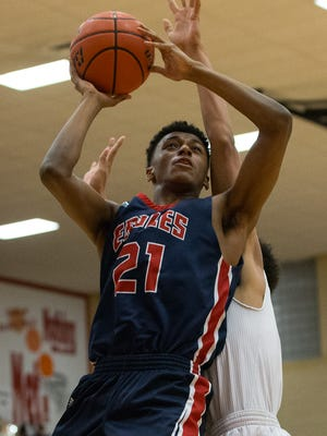 Veterans Memorial's Elijah Hinton jumps to score during the third quarter of the Region IV-5A quarterfinals at Ray High School on Tuesday, Feb. 28, 2017.