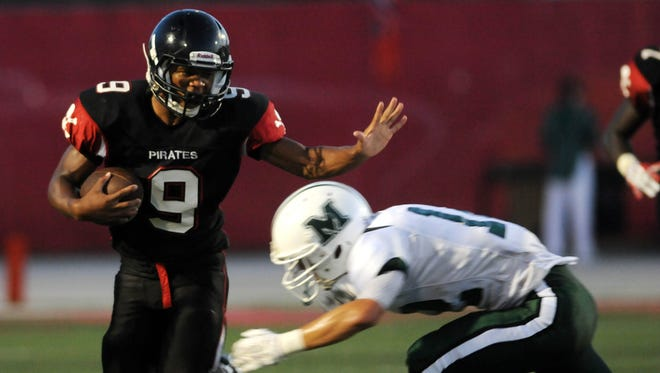 Palm Bay's Brian Lankford-Johnson tries to get past Melbourne's Brandon Mara after an interception during Friday's game at Palm Bay High School