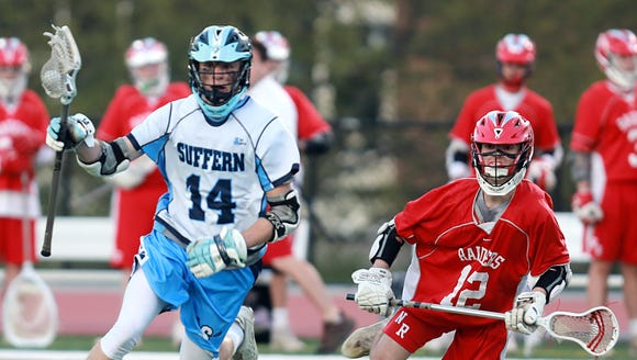 Suffern Aaron Johnson (14) tries to keep the ball from