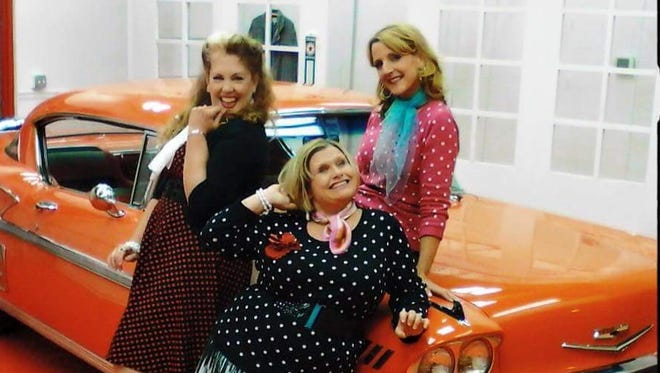 A 2015 promotion photo for 'Divalicious: A Musical Tribute to Great Ladies' shows, from left, Kimberli Maloy, Nikki Savitt and Deborah Kennedy (on car).