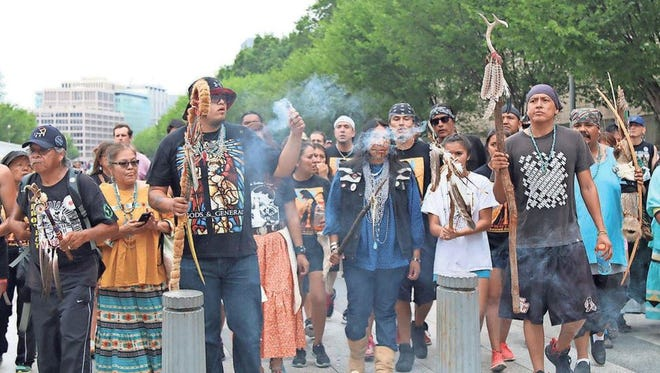 Members of the San Carlos Apache Tribe march in Washington, D.C., to protest the proposed Resolution Copper mine.