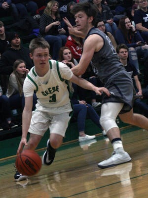 Wethersfield's Waylon Bryant (3) drives to the lane.