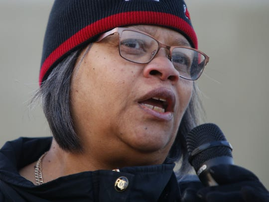 Community activist Penny Dees, speaks during crime