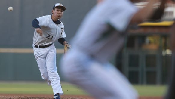 Faith Christian starting pitcher Pablo Cortes delivers