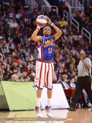 "Brawley ""Cheese"" Chisholm hits a 4-point shot in a game with the Harlem Globetrotters. The Cherokee grad will host a basketball game at Katz JCC in Cherry Hill in August."