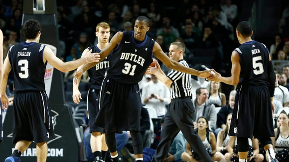 Jan 21, 2014; Providence, RI, USA; Butler Bulldogs forward Kameron Woods (31) celebrates with guard Alex Barlow (3) and guard Elijah Brown (5) during the first half of a game against the Providence Friars at Dunkin Donuts Center.