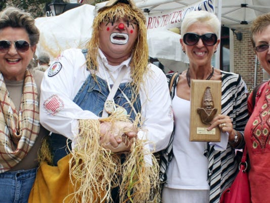 Corn-eating contest winner Michelle Waltz and friends pose for a picture with Corny the Clown at the 2014 Corn Festival in Shippensburg.