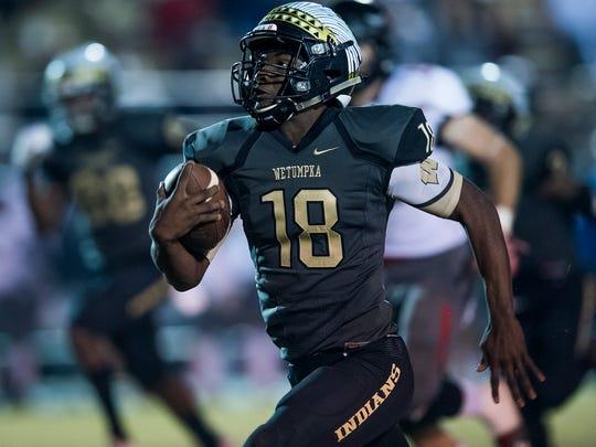 Wetumpka quarterback Jadarious Martin (18) scores a long touchdown against Spanish Fort in Wetumpka, Ala. on Friday November 24, 2017.