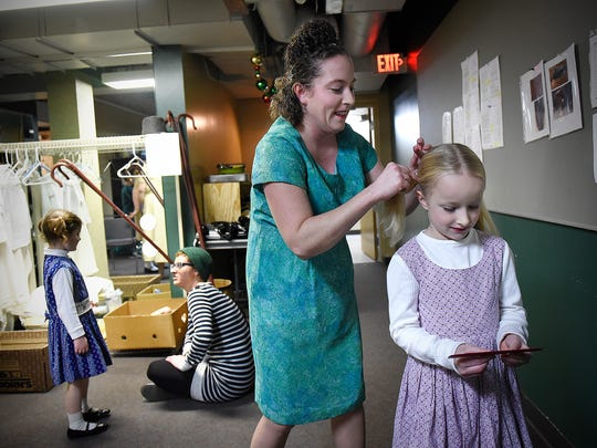 """Jessica Outhwaite combs her daughter Ariana's hair in the green room Friday before the opening show of GREAT Theatre's production of """"The Best Christmas Pageant Ever"""" at the Paramount Theatre in St. Cloud."""