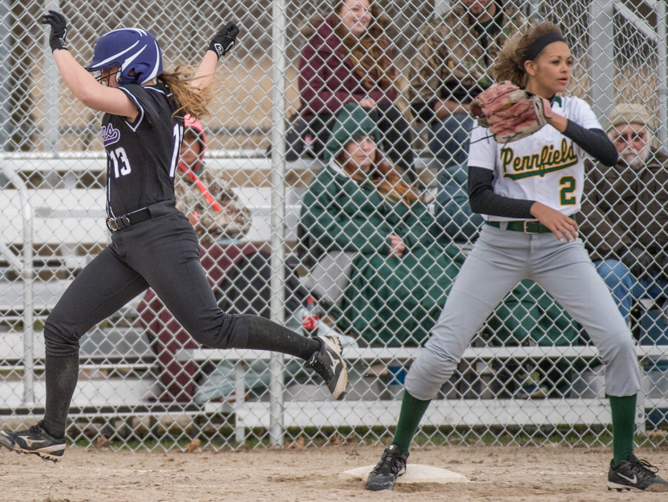 Lakeview's Maddie Wilson (13) runs to first while Pennfield's Alexa Stephenson (2) covers.