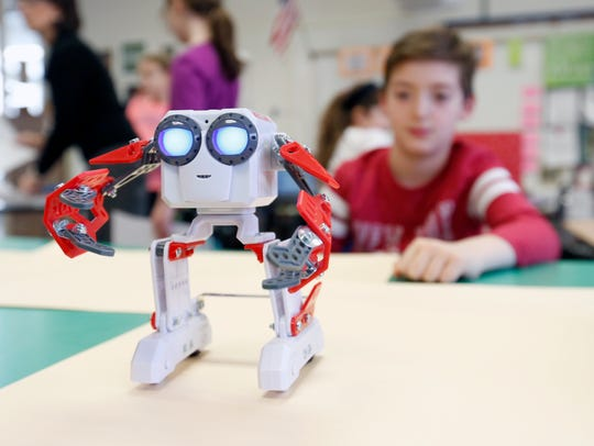 """Bryson Turco, 9, with his robot """"red socket"""" at the"""
