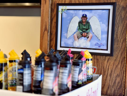 An artistic rendering of Skyler Montgomery hangs near the bar at Dead Lightning Still Works in New Cumberland.