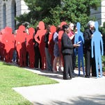 Volunteers participate in domestic violence awareness event at the South Carolina statehouse on Oct. 7, 2014.