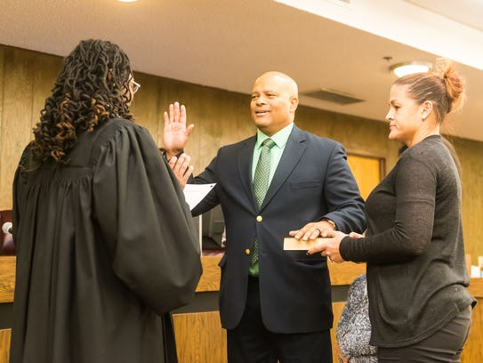 Bruce Cooper is sworn into the Millville City Commission