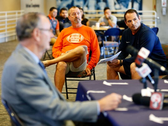 UTEP defensive coordinator Tom Mason, center, and offensive coordinator Brian Natkin, right, listen to athletic director Bob Stull talk about naming an interim head football coach during a news conference Monday.