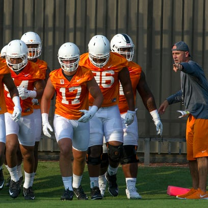 Tennessee defensive backs coach Willie Martinez directs