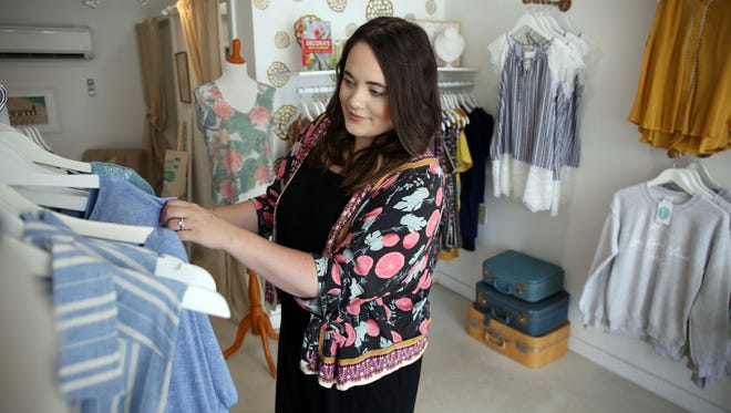 Small Business Spotlight on A Lovely Universe, a Beach Haven shop that sells women's clothing, gifts and stationery. Owner Sarah Cunningham Mastriano shows off her merchandise. Beach Haven, New Jersey. Tuesday, July 11, 2017. David Gard /Correspondent