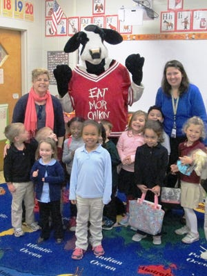The Chick-fil-A Cow visited kindergarten classes at Cumberland Christian School in Vineland on Nov. 30. The students were excited when he walked into the rooms, and they loved giving him hugs and high-fives. The Chick-fil-A Cow gave the children reindeer hats for Christmas. He is pictured with teachers Jessica Haenn and Allison Sweeney and their students.