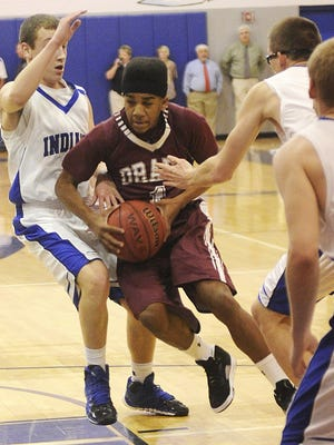 Stuarts Draft's Jamal Simpson attempts to drive the ball through Fort Defiance's Brendan Crowe during the Conference 29 Tournament quarterfinals boys' basketball game on Tuesday, Feb. 18, 2014, in Fort Defiance.
