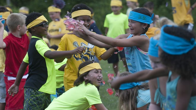 Kids from Camp SAM in Sewell take part in the annual summer Jell-O Wars events during the week of Color War. The camp produced 500 gallons of Jello-O in all different colors for the all-out giant food fight with both kids and counselors joining in the fun.