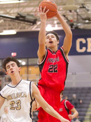 Pinckney's Kolton Pavlicek (22) of Pinckney is one of two returning first-team All-County boys' basketball players in 2016-17.