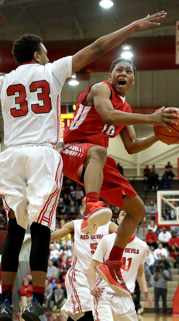 Pike's Justin Roberts,right, drives on Richmond's Auntonio