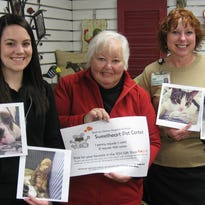 (L-R) Britany Kuhn, caregiver representative, Gay Baker, auxiliary member, and Nan Simons, director of marketing and volunteers, display photographs of the top four finalists along with a poster containing contest information for the Hospital Sweetheart Pet Contest.