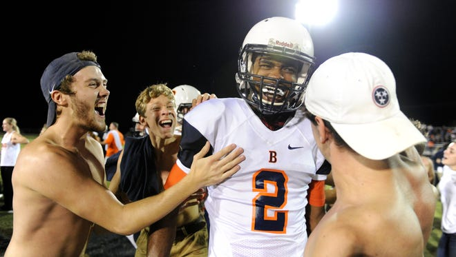 Blackman students run onto the field to celebrate with quarterback Jauan Jennings after beating Independence on Friday.