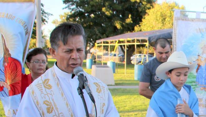 Fr. Manuel Ibarra led a Mass following Friday's procession at Viramontes (Milo) Park.