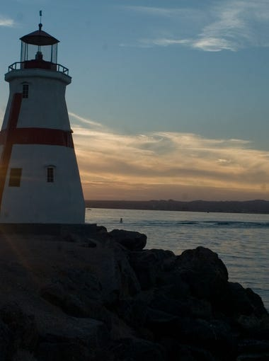Sunset by a lighthouse at Lake Havasu State Park.