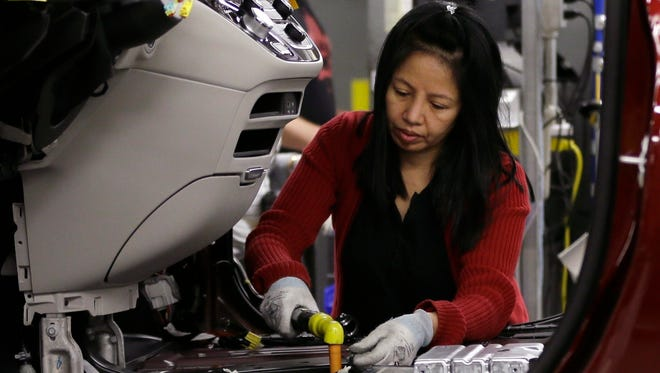 Tina Nguyen works on a 2017 Chrysler Pacifica on an assembly line at the Windsor Assembly Plant, in Windsor, Ontario.Fiat Chrysler Automobiles announced that during the following week, the company plans to stop producing new vehicles in North America with the most dangerous type of Takata air bag inflators.