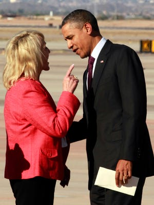 "Arizona Gov. Jan Brewer points at President Barack Obama after he arrived at Phoenix-Mesa Gateway Airport, Wednesday, Jan. 25, 2012, in Mesa, Ariz. Brewer greeted Obama and what she got was a book critique. Of her book. The two leaders engaged in an intense conversation at the base of Air Force Oneís steps. Both could be seen smiling, but speaking at the same time. Asked moments later what the conversation was about, Brewer, a Republican, said: ""He was a little disturbed about my book."" Brewer recently published a book, ""Scorpions for Breakfast,"" something of a memoir that describes her years growing up and defends her signing of Arizonaís controversial law cracking down on illegal immigrants, which Obama opposes. Brewer also handed Obama an envelope with a handwritten invitation for Obama to return to Arizona to meet her for lunch and to join her for a visit to the border.  (AP Photo/Haraz N. Ghanbari)"